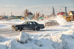 Old Russian cars Lada 2101 and 2104 prepared for racing drive on the ice on a frozen lake, drifting and moving in a skidder in a. Novosibirsk, Russia - 02.02 royalty free stock photo