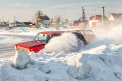 Old Russian cars Lada 2101 and 2104 prepared for racing drive on the ice on a frozen lake, drifting and moving in a skidder in a. Novosibirsk, Russia - 02.02 royalty free stock images