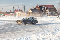 Old Russian cars Lada 2101 and 2104 prepared for racing drive on the ice on a frozen lake, drifting and moving in a skidder in a. Novosibirsk, Russia - 02.02 stock photo