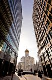 Old russian church between two modern skyscrapers Royalty Free Stock Images