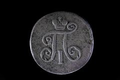 Old Russian coin 1 Denga 1798 on black isolated background stock photos