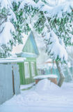 Old Russian country house covered with snow Stock Photography