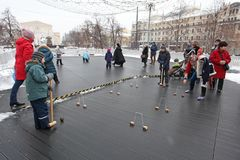Old Russian game Lapta similar to crisket and baseball. Children and adults play old Russian game Lapta similar to Cricket and Baseball during Butter Week Stock Image