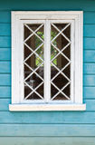 Old Russian house fragment, blue wall and white window Stock Photo