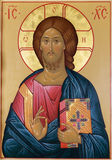 Old Russian icon. Image of Christ with the gospel and the hand of blessing on the ancient Russian icon Stock Images