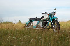 Old Russian Motorcycle. An old Russian motorcycle parked in the countryside fields Stock Image