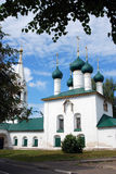 Old Russian orthodox church building in Yaroslavl. Tree trunks. Stock Photography