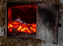 The old Russian oven smolder coals Stock Photography