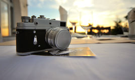 Old russian photo camera. An old photo camera on a table at the sunset Royalty Free Stock Photography