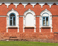 Old Russian red brick wall with windows Stock Image