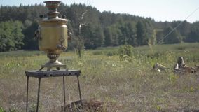 Old Russian samovar stay on the grpound. Selective fokus. stock footage