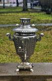 Old russian samovar water boiler. Old russian  water boiler on wood table Stock Photography
