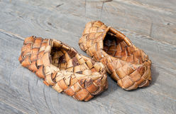 Old russian sandals made of bark Stock Photos
