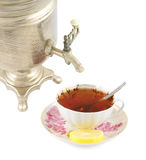 Old russian tea samovar and cup of tea with lemon Royalty Free Stock Images
