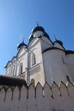 Old Russian temple with white walls and blue sky Stock Images