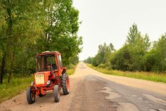 Old Russian tractor on gravel road Royalty Free Stock Photography