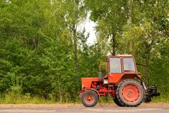 Old Russian tractor on gravel road Royalty Free Stock Images