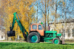 Old russian tractor with loader Royalty Free Stock Image