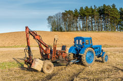 Old russian tractor with loader Stock Images