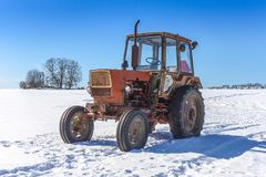 Old Russian tractor in snow. Y field royalty free stock photos