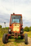 Old Russian tractor in the yard of a farm Royalty Free Stock Photo