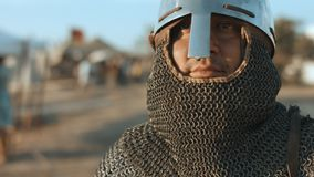 Old Russian warrior before the battle. Old Russian warrior in the helmet and chainmail before the battle stock footage