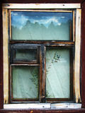 Old russian window. Old window with reflection of forest Stock Images