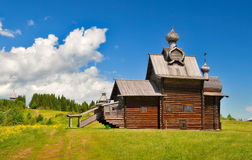 Old russian wooden church. Under the blue sky with cloud Royalty Free Stock Images