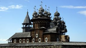 Old Russian wooden Church, the Church in the field, a wonderful rustic look, the background. Royalty Free Stock Photo