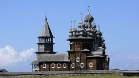 Old Russian wooden Church, the Church in the field, a wonderful rustic look, the background. Old wooden churches on island Kizhi on Onega lake in region Karelia Royalty Free Stock Photography