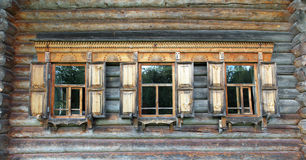 Old russian wooden house with decorated windows Royalty Free Stock Photography