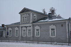 Old russian wooden house designed by carved window frames. In Kolomna, Russia stock images