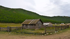 Old Russian wooden house in village. Royalty Free Stock Image
