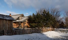 An old Russian wooden hut. Winter landscape with a traditional Russian log house. Royalty Free Stock Photography