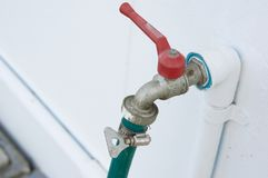 Old and rust chrome faucet connect with water hose belt. Old and rust chrome faucet or tap with pvc pipeline painted white connect with water hose by belt on Royalty Free Stock Photos