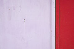 Old and rust pink and red metal door Stock Photo