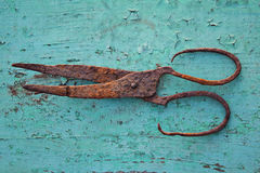 Old rust scissor on green painted background Royalty Free Stock Photo