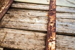 Old rust steel panel on wooden pole stock photography