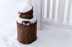 Old rusted can. On snow-covered terrace in Finland Stock Image