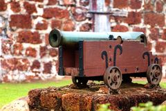 Old cannon in front of fortress wall Stock Photography