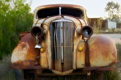 Old rusted car. With broken headlights Royalty Free Stock Images