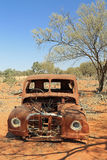 Old rusted car in the Australian Outback. Abandoned rusting car sitting in the dirt in the Australian Outback Stock Photos