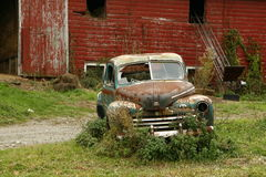Old rusted Car & Barn Stock Photography