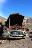 Old rusted car in junk yard Stock Image