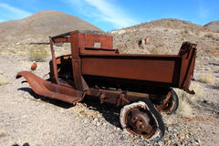 Old rusted car in junk yard. National park Death valley, USA Royalty Free Stock Photography
