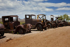 Old Rusted Cars. Old rusted antique cars long forgotten Stock Photo