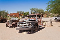Old rusted cars. In front of the gas station Solitaire, Namibia Stock Image