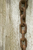 Old rusted chain. Over a wooden surface Stock Photography