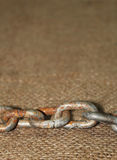 Old rusted chain with jute cloth Stock Photo