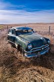 Old rusted classic car in Washington field. Stock Photography